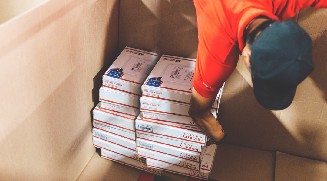 Packages being prepared for shipping by Chit Chats employee